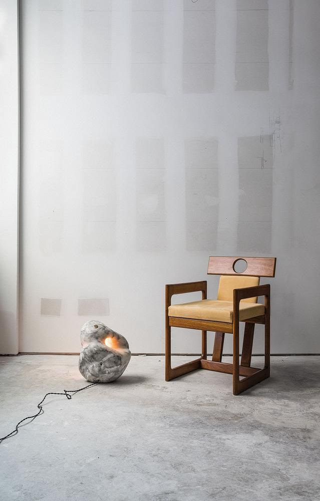 FRESH PAIR A 2016 Rogan Gregory lamp stands next to a 1985 Sérgio Rodrigues chair.