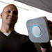 Tony Fadell, the founder and chief executive of Nest, holding up his company's Protect smoke alarm.