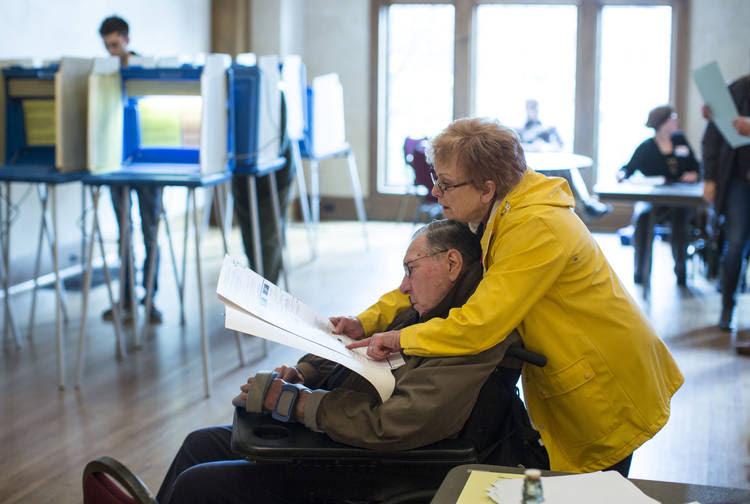 Henry and Lenora Elsesser go over a ballot before voting in Milwaukee, Wis., last November. (Tom Lynn for The Washington Post)