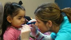 Photo of a child being examined by a dentist