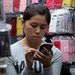 A vendor selling phone cases in Guangzhou, China. Samsung's bigger-screen smartphones have sold well in Asian markets.