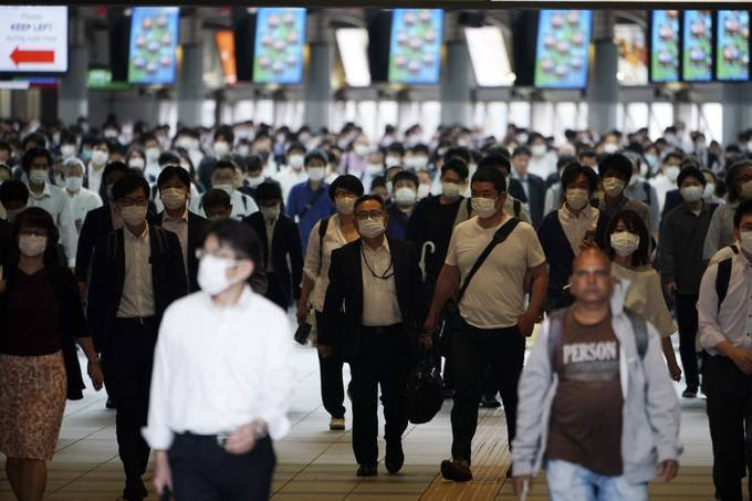 A Tokyo train station is crowded with commuters on Tuesday. (Eugene Hoshiko/AP)