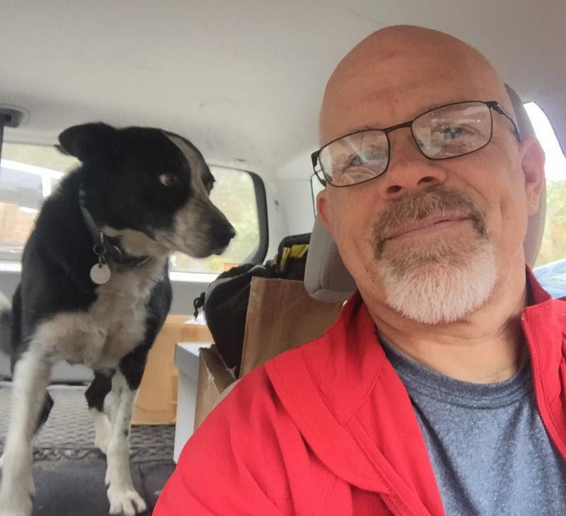 Tom and his dog Bridger in their car_ ready for adventure.