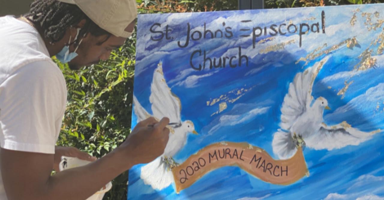 Muralist paints an image for St. John's Episcopal Church 2020 Mural March
