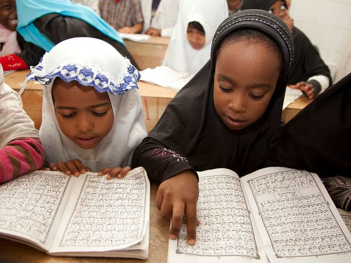 Children recite passages from the Quran at an Islamic school in Nairobi, Kenya.