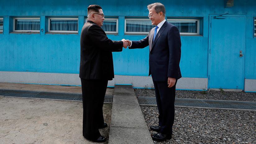 FOTOS: Apretón de manos para la posteridad entre Kim y Moon