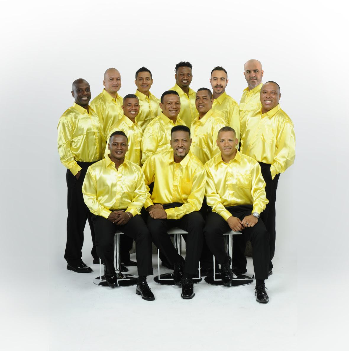Grupo niche camisa amarilla 1