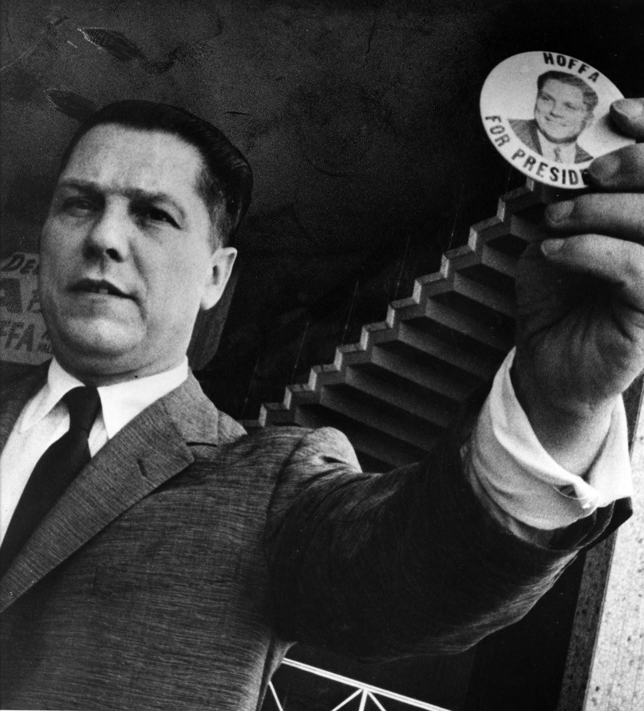 "Jimmy Hoffa holds a ""Hoffa for President"" button during his 1959 campaign for the Presidency of the Teamsters Union. Today is the 37th anniversary of Jimmy Hoffa's disappearance. Last seen at the Machus Red Fox Restaurant in Bloomfield Hills, Hoffa..."
