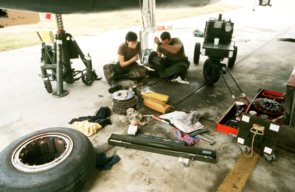 two-maintenance-crewmen-repair-a-set-of-