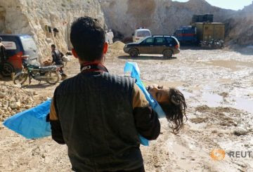 a-man-carries-the-body-of-a-dead-child-after-what-rescue-workers