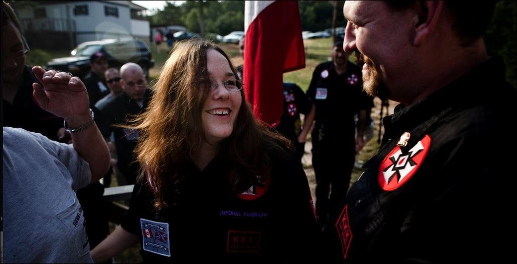 "Chris and Amanda Barker on July 2, 2011, receiving a ""certificate of friendship"" commendation at a Ku Klux Klan rally in Southeast Virginia. Later that night, a nearby synagogue was defaced with a Nazi Swastika. Both Barker's are chief suspects in open case criminal investigations by the FBI and local Virginia law enforcement."