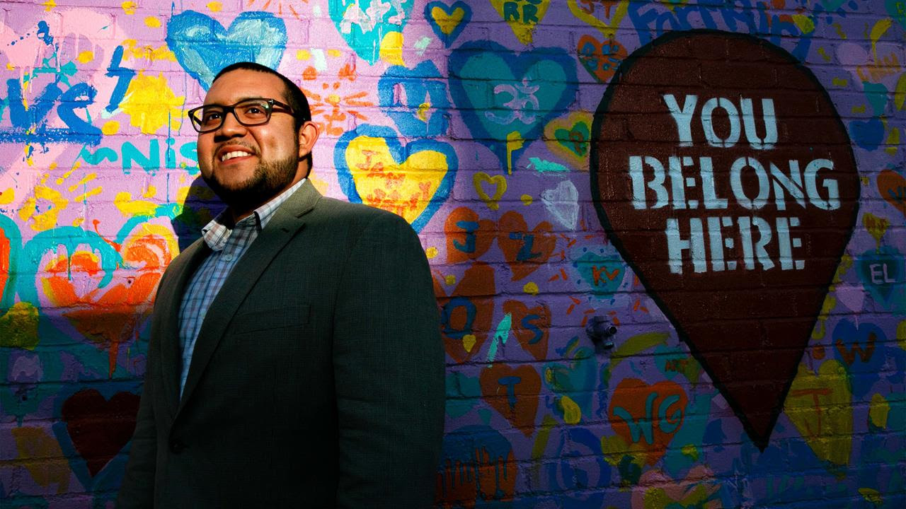 Ricky Hurtado, the first Latino candidate to run for North Carolina's House of Representatives, poses for a portrait by a mural in Graham on March 10, 2020. In November, the 32-year-old son of a Salvadoran immigrant won a seat in the North Carolina Legi