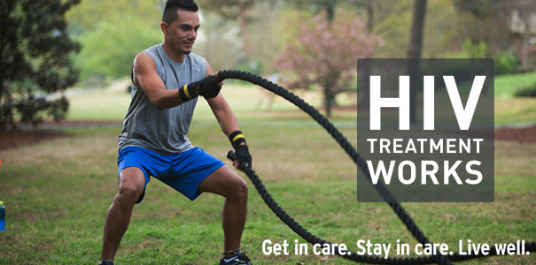 Physically fit man exercising with ropes