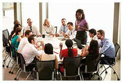 https://www.hr360.com/images/newsletter/Businesswoman-speaking-to-others-around-table.jpg