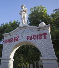 These photos of vandalized Confederate monuments show the battle ...