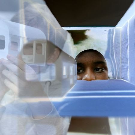A young person looking through the new installation for My Model City