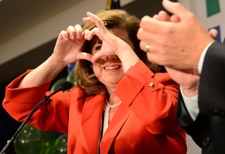 Karen Handel makes a heart sign with her fingers as she thanks supporters during his victory speech last night. (Bita Honarvar/Reuters)</p>