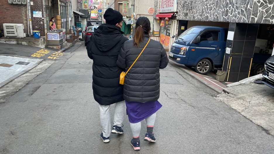 Kim Ju-won (left) and Park Sun-min (right) say same-sex couples in South Korea are excluded from incentives to start families.