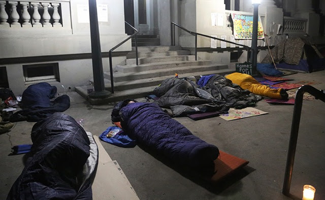 Homeless advocates sleep in sleeping bags overnight in front of old City Hall to protest proposed measures which they say will make life more difficult for the homeless, in Berkeley, on Tuesday, Nov. 17, 2015. The temperature was to drop to 46 degrees Fahrenheit overnight. Photo: David Yee ©2015