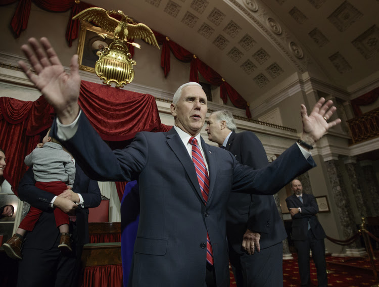 Mike Pence attends a swearing-in ceremony at the Capitol yesterday for Luther Strange, who was appointed to replace Attorney General Jeff Sessions as Alabama's senator. (J. Scott Applewhite/AP)</p>