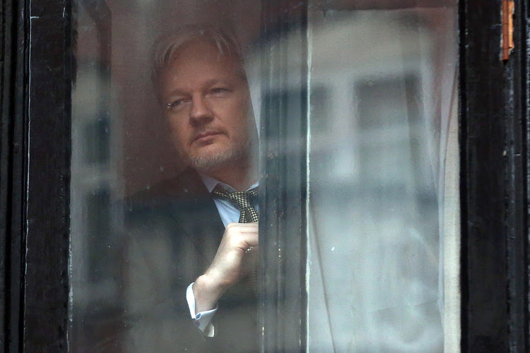 Julian Assange is hiding out in the Ecuadorian embassy of London to avoid facing prosecution. (Carl Court/Getty Images)</p>