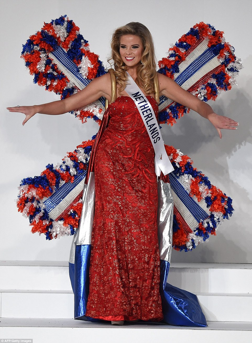 There's no prizes for guessing what inspired Miss Netherlands' outfit. Rachel van der Meulen went all out patriotic dressed in her nation's flag colours of red white and blue, plus she adorned Holland's icon on her back in the form of windmill wings.