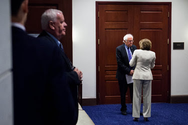 Senator Bernie Sanders talked with the House minority leader, Representative Nancy Pelosi, outside a Democratic caucus meeting on Capitol Hill on Wednesday.