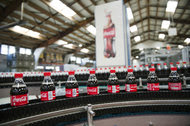 Bottles of Coca-Cola on an assembly line at a factory near Paris.