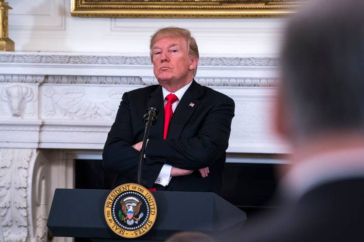 President Trump listens to Gov. Jay Inslee (D-Wash.) speak against his plan to arm teachers during a meeting with the nation's governors at the White House. (Jim Lo Scalzo/European Pressphoto Agency)