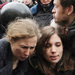 Riot police detained Maria Aliokhina, left, Nadezhda Tolokonnikova, center, and her husband Piotr Verzilov during a protest in Moscow on Monday.