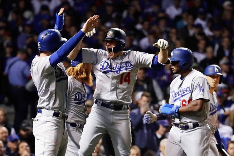 Enrique Hernandez of the Los Angeles Dodgers celebrates with teammates after hitting a grand slam during Game 5 of the NLCS. (Jamie Squire/Getty Images)