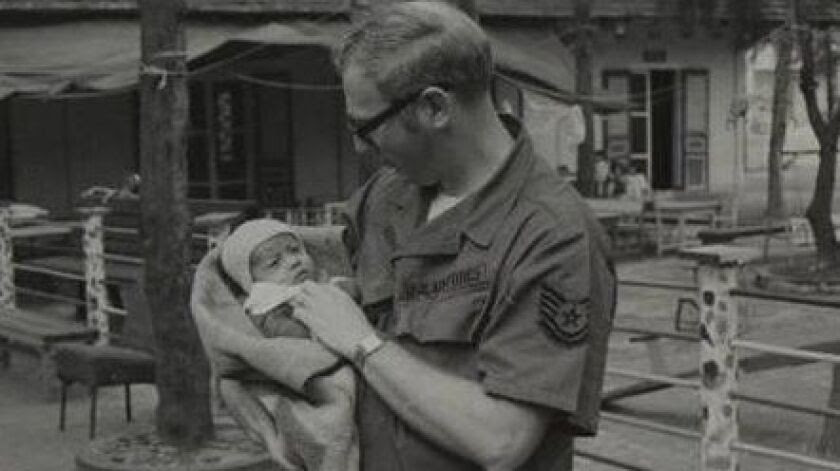 Tech Sgt. James Mitchell and the baby who would later be renamed Kimberly Mitchell