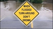 Road sign telling drivers to Turn Around, Don't Drown