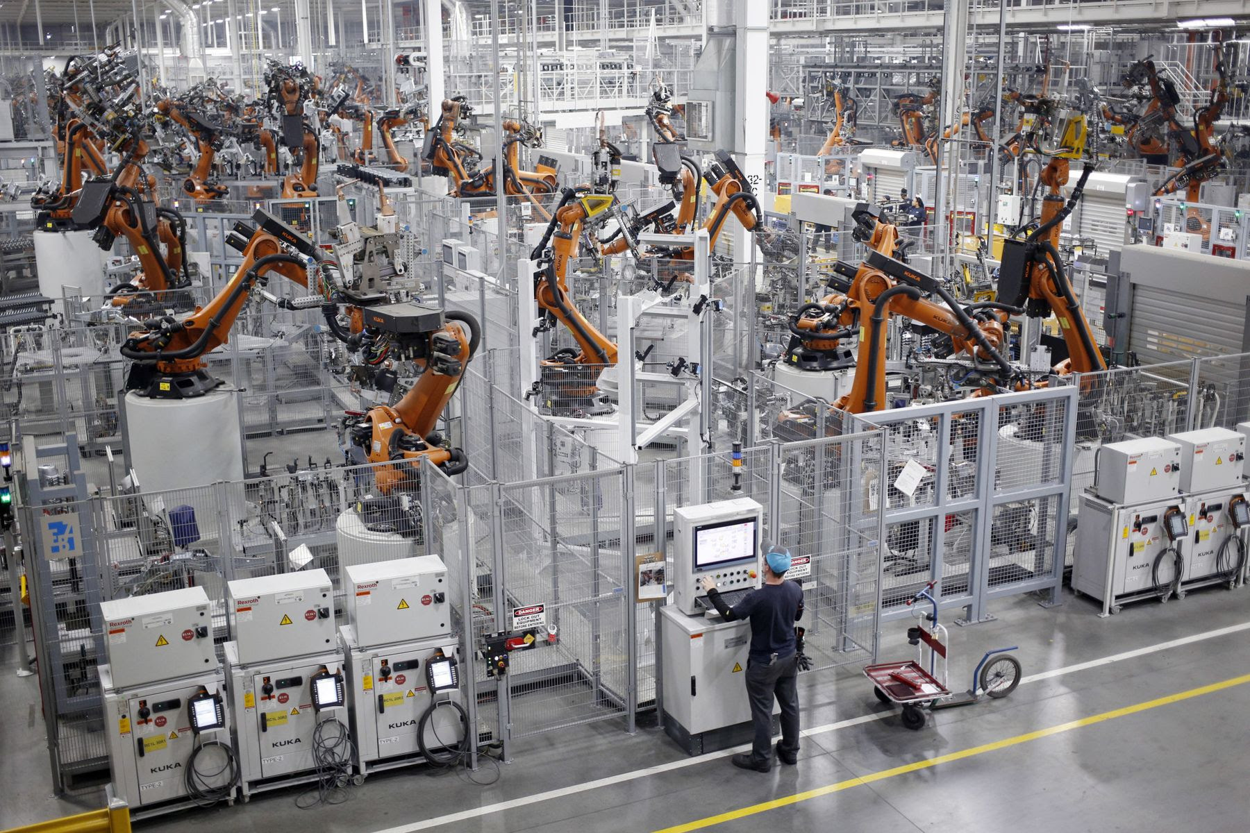 Robots weld car body components for vehicles at an assembly plant in Greer, South Carolina.