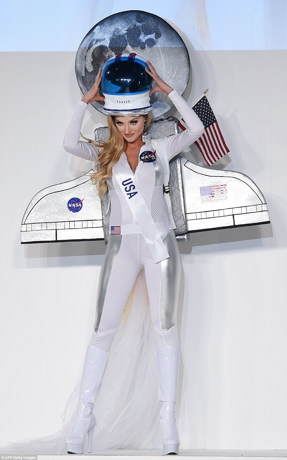 Lindsay Becker teamed a skintight white and silver catsuit adorned with a NASA badge with knee-high white PVC boots and an astronaut helmet. She also wore a cardboard spaceship as a backpack, complete with firing jets, a sparkly American flag and a moon, which created an ethereal halo above Lindsay's head
