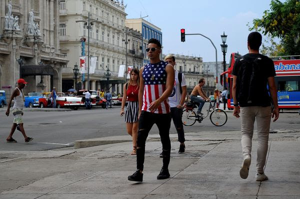 A Cuban wearing a T-shirt with the U.S. flag walking in&nbsp;Havana on June 15. (Yamil Lage/Agence France-Presse via Getty Images)</p>