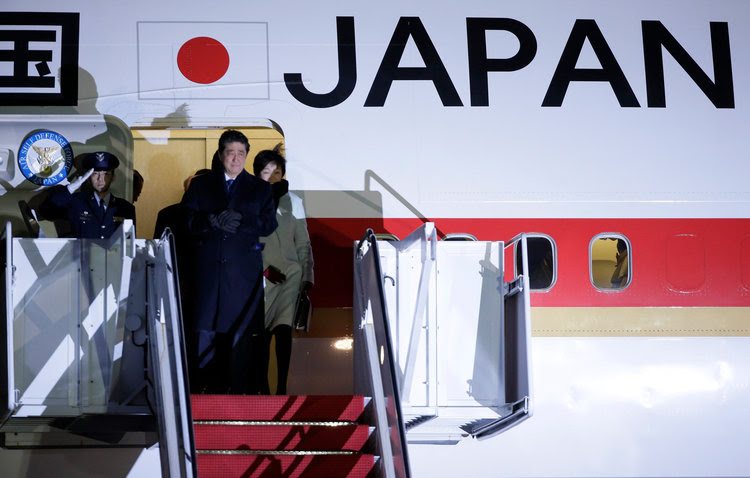 Japanese Prime Minister Shinzo Abe and his wife Akie Abe arrive at Joint Base Andrews. (Reuters/Joshua Roberts)</p>