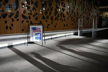 Early voting last week at the Central Library in Madison, Wis. Much of Wisconsin's restrictive elections law was invalidated in July.