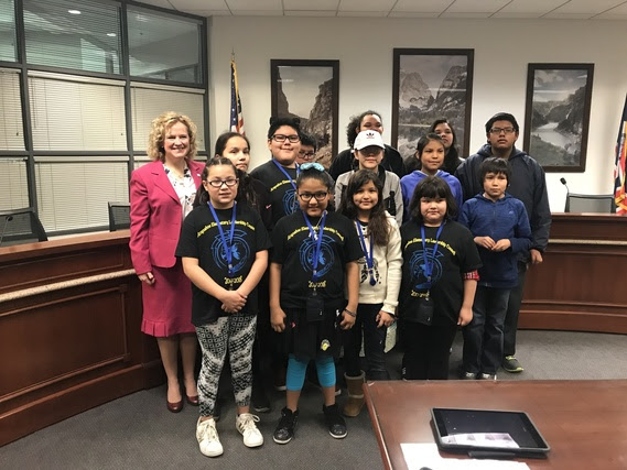 The State Superintendent with a group of elementary, middle, and high school students from Arapahoe School that serve on the student council.