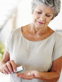 Woman looking at medication
