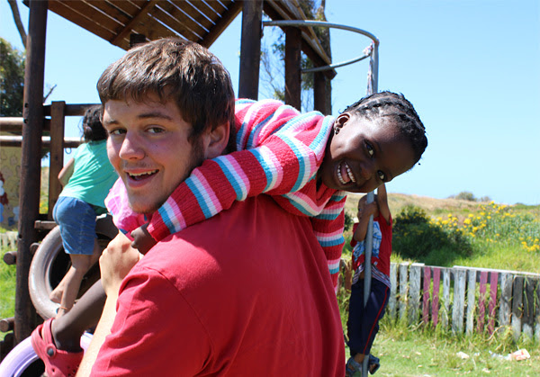 A Projects Abroad volunteer and a local child during playtime at a Care placement in Cape Town, South Africa