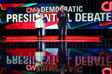 After the introductions at Thursday night's debate, Senator Bernie Sanders went on the attack while Hillary Clinton countered with confidence and resolve.