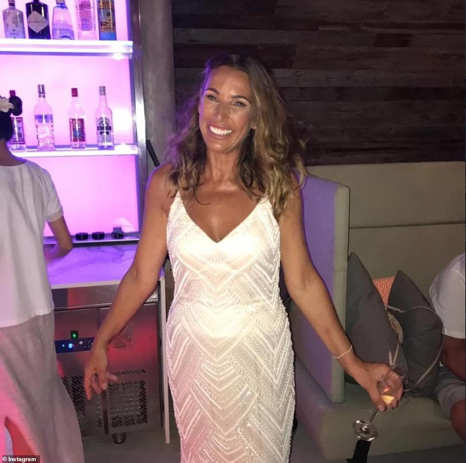 Flawless: Mother of the bride Sue looked equally stunning in a fitted white beaded dress for the big day, as she beamed with pride at seeing her daughter tie the knot