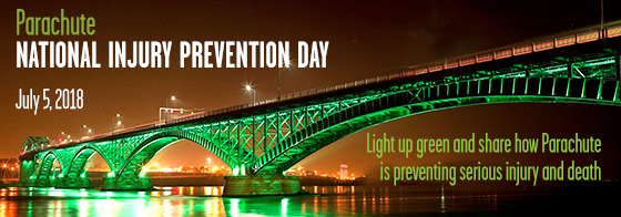 Bridge over water lit green for National Injury Prevention Day July 5 2018