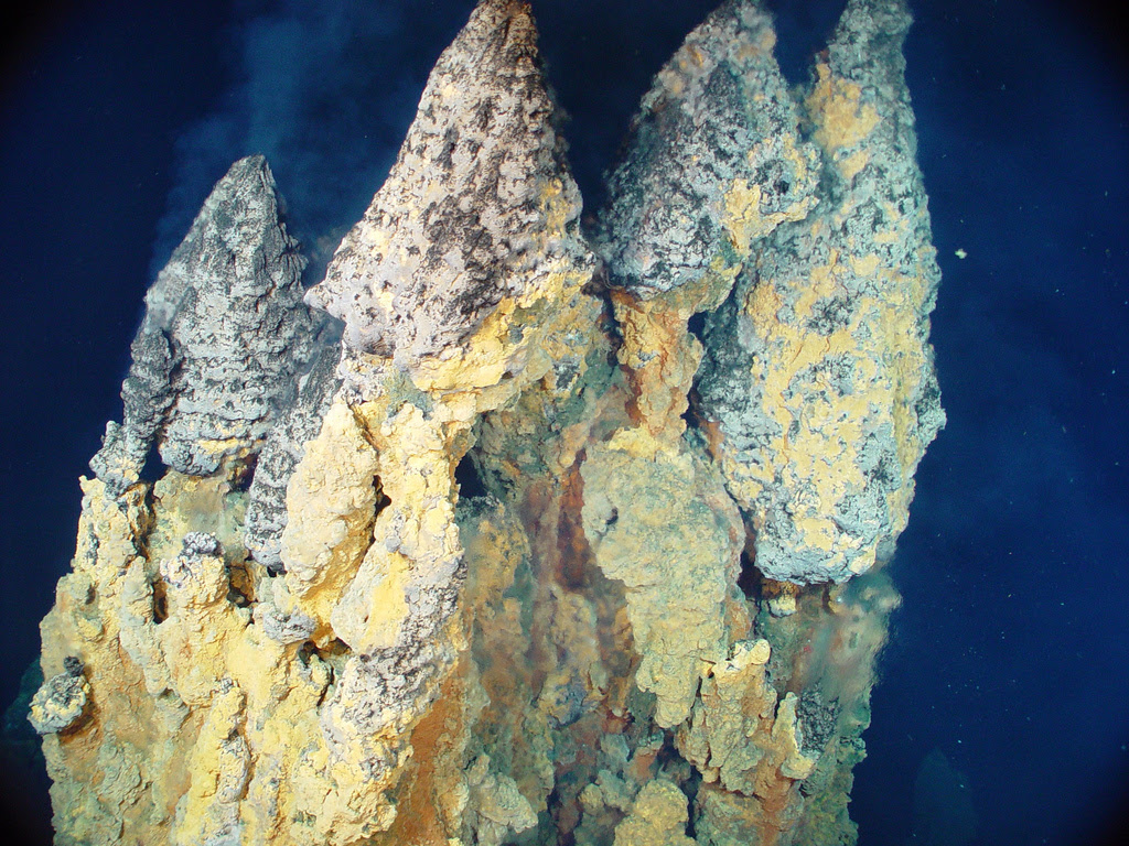 "Active ""smoker"" chimneys precipitating iron, copper and zinc sulfides from 230øC fluid. Photo courtesy of Pacific Ring of Fire 2004 Expedition. NOAA Office of Ocean Exploration; Dr. Bob Embley, NOAA PMEL, Chief Scientist."