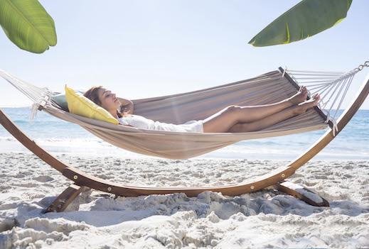 Woman lying on hammock