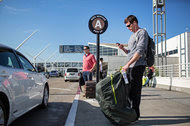 Passengers at Los Angeles International Airport waiting for Uber drivers, an alternative to cabs and rental cars.