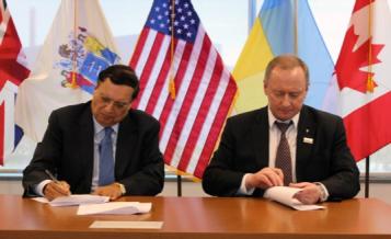Energoatom President, Yuriy Nedashkovsky, and Holtec's CEO, Dr. Kris Singh, Executing the Memorandum of Understanding