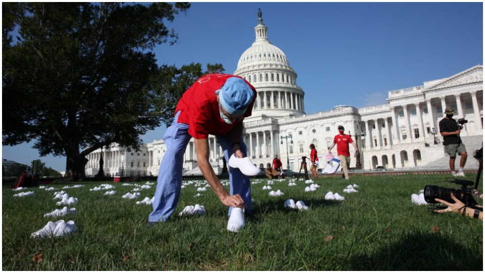 Bringing empty shoes to honor the dead, nurses descend on Capitol