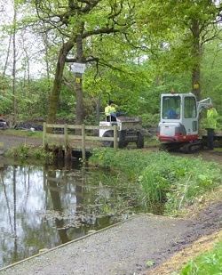 Maintenance work being carried out at a fishery